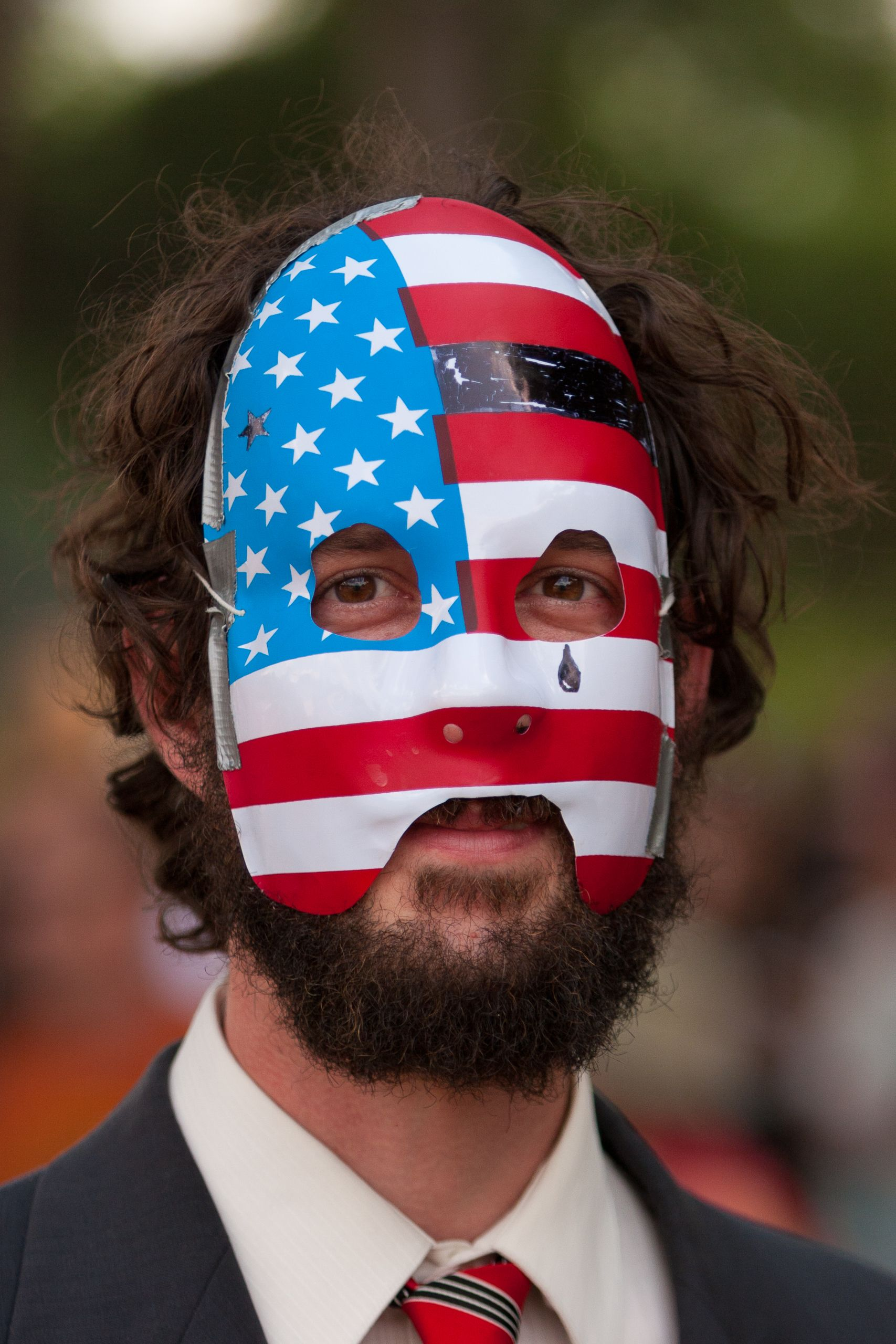 Man in suit and America mask