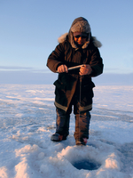 Ice fishing on the Sea ice, Nunavut, Arctic photographer