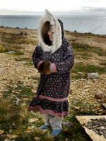 Inuit elder wearing sunburst parka