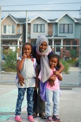 Mother & children, schoolyard, Toronto