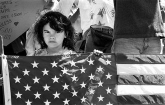 Child with flag at troop support rally, San Diego, CA