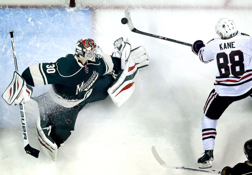 Patrick Kane (88) shot the puck past Minnesota Wild goalie Ilya Bryzgalov (30) to beat the Wild 2-1 in overtime.