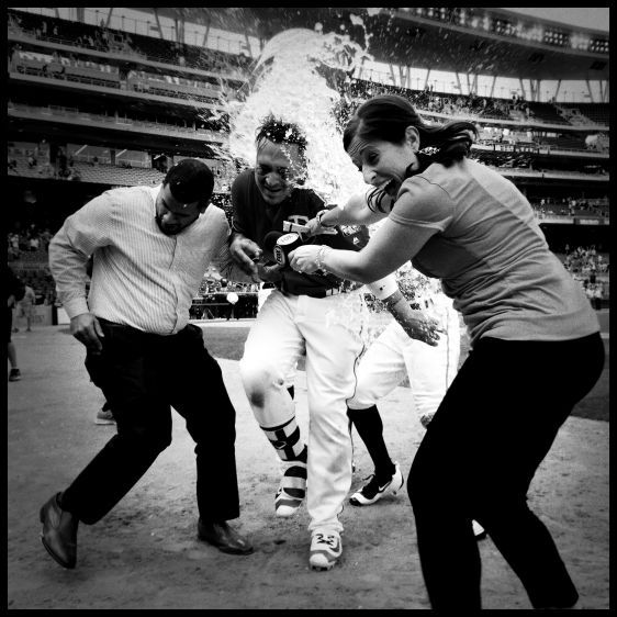 Oswaldo Arcia splashed by teammate Miguel Sano.