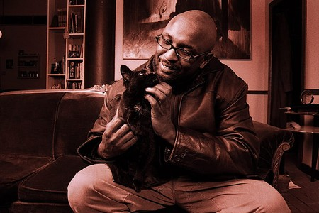 man with cat, editorial portraits