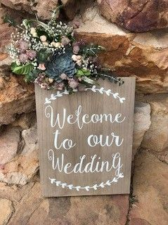 Outdoor welcome sign with flowers