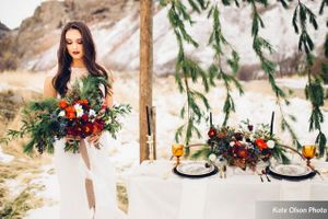 Romantic_Winter_Shoot_Bride_with_Colorful_Flowers_Backdrop.jpg