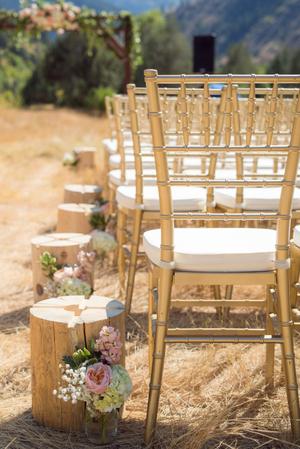 Kristin_Haven_Blacksmith_Fork_Canyon_Ceremony_Gold_Chiavari_Chairs_Wood_Stump_Decor.jpg