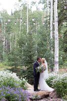Evelyn_Kevin_Park_City_Utah_Bride_Groom_Kissing_Bridge.jpg