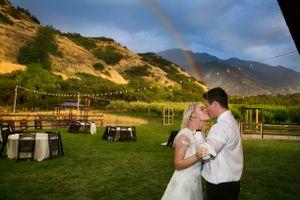 Tori_Sterling_Quiet_Meadow_Farms_Mapleton_Utah_Bride_Groom_Kissing_in_Front_of_Rainbow.jpg