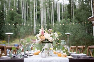 Evelyn_Kevin_Park_City_Utah_Reception_Dinner_Table_Bistro_Lights_Sage_Blush_White_Centerpieces.jpg