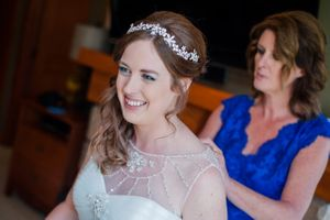Ashley_Dan_Solitude_Resort_Solitude_Utah_Brides_Mother_Zipping_Up_Brides_Dress.jpg