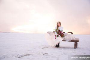 Salt_Air_Wedding_Shoot_Saltair_Resort_Salt_Lake_City_Utah_Sun_Shining_Through_Clouds_Bride_Sitting_on_Fainting_Couch.jpg