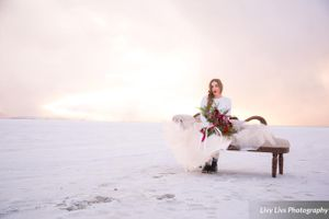 Salt_Air_Wedding_Shoot_Saltair_Resort_Salt_Lake_City_Utah_Sun_Shining_Through_Clouds_Bride_Sitting_on_Fainting_Couch.jpg