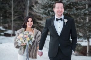 Julia_Mark_Silver_Lake_Lodge_Deer_Valley_Resort_Park_City_Utah_Smiling_Bride_Groom_Walking_In_Snow.jpg