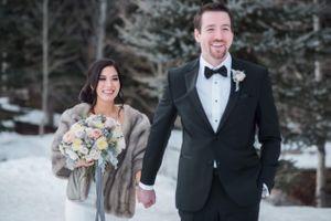 Julia_Mark_Silver_Lake_Lodge_Deer_Valley_Resort_Park_City_Utah_Smiling_Bride_Groom_Walking_In_Snow.jpg