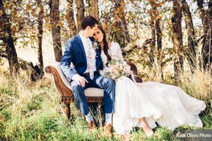 Charming_Barn_Wedding_Quiet_Meadow_Farms_Mapleton_Utah_Bride_Resting_Grooms_Shoulder_Swan_Fainting_Couch.jpg