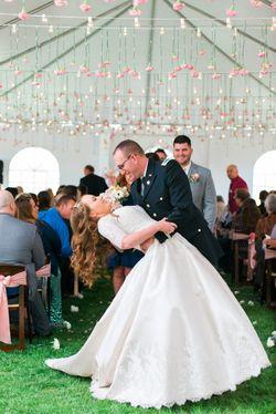 Katelyn_David_Park_City_Utah_Couple_Kissing_Under_Carnation_Bistro_Light_Ceiling.jpg