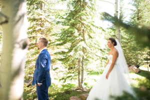 Chelsea_Walker_Red_Cliff_Ranch_First_Look_Bride_Approaches.jpg