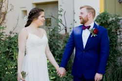 Liz_Jordan_Tracy_Aviary_Salt_Lake_City_Utah_Bride_and_Grrom_Holding_Hands.jpg
