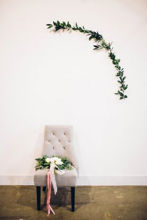 Modern_Industrial_Wedding_Shoot_The_Historic_Startup_Building_Provo_Utah_Comfortable_Chair_Simple_Greenery.jpg