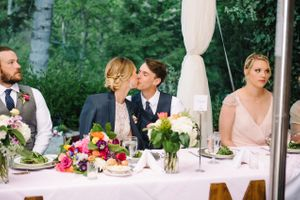 Claire_Scott_Millcreek_Inn_Salt_Lake_City_Utah_Bride_Groom_Kissing_Head_Table.jpg