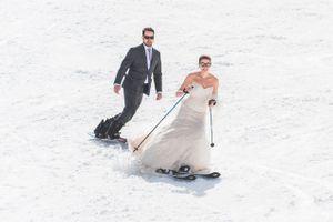 Ilana_Dave_Canyons_Resort_Park_City_Utah_Fun_Bride_Groom_Skiing_in_Wedding_Dress_Suit.jpg