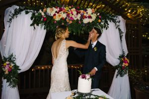 Claire_Scott_Millcreek_Inn_Salt_Lake_City_Utah_Bride_Feeding_Groom_Cake.jpg