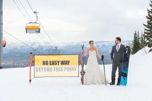 Ilana_Dave_Canyons_Resort_Park_City_Utah_Bride_Groom_No_Easy_Way_Sign_on_Ski_Slopes.jpg