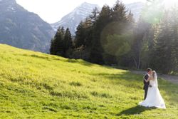 Lenora_John_Sundance_Resort_Sundance_Utah_Bride_Groom_Kissing_Mountain_Field.jpg