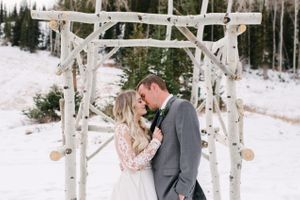 Rocky_Mountain_Bride_Winter_Elopement_Deer_Valley_Empire_Lodge_Deer_Valley_Resort_Park_City_Utah_Bride_Groom_Kiss_Aspen_Arch.jpg