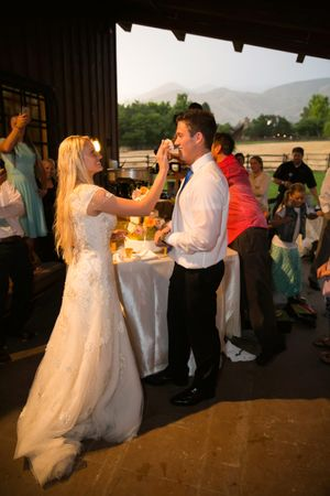 Tori_Sterling_Quiet_Meadow_Farms_Mapleton_Utah_Bride_Groom_Feeding_Each_Other_Wedding_Cake.jpg