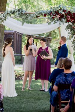 Liz_Jordan_Tracy_Aviary_Salt_Lake_City_Utah_Vows_Under_Flower-Decked-Chuppah.jpg