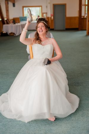 Ashley_Dan_Solitude_Resort_Solitude_Utah_Bride_Answering_Question_With_Shoe_During_Reception_Quiz.jpg