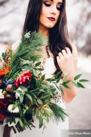 Romantic_Winter_Shoot_Bride_Holding_Flower_Bouquet.jpg