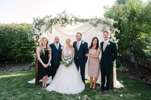 Tasha_Chip_Salt_Lake_City_Utah_Bridal_Party_in_Front_of_Floral_Crowned_Backdrop.jpg