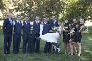 McCall_Brad_High_Star_Ranch_Kamas_Utah_Groom_Holding_Bride_Bridesmaids_Groomsmen.jpg