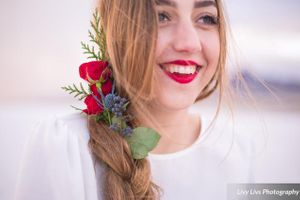 Salt_Air_Wedding_Shoot_Saltair_Resort_Salt_Lake_City_Utah_Smiling_Bride_Floral_Hair_Accent.jpg