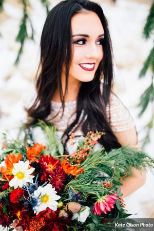 Romantic_Winter_Shoot_Smiling_Bride_Vibrant_Flowers.jpg