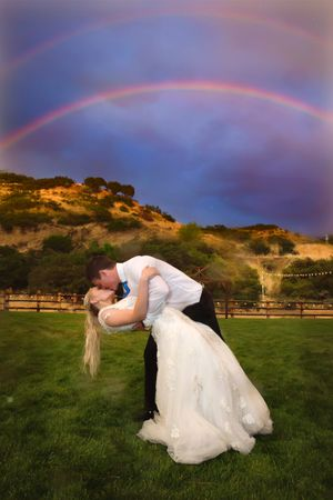 Tori_Sterling_Quiet_Meadow_Farms_Mapleton_Utah_Bride_Groom_Kissing_Double_Rainbow.jpg