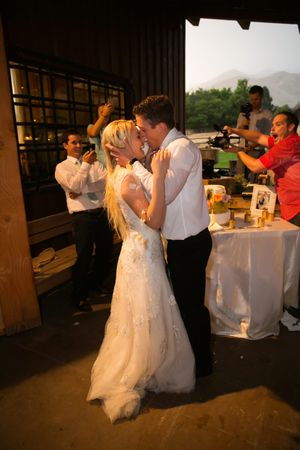 Tori_Sterling_Quiet_Meadow_Farms_Mapleton_Utah_Bride_Groom_Kiss_After_Cake_Cutting.jpg
