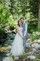 Ashley_Dan_Solitude_Resort_Solitude_Utah_Bride_Groom_Embracing_Beside_Mountain_Streem.jpg