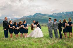 Katelyn_David_Park_City_Utah_Bride_Groom_Kissing_Bridesmaids_Groomsmen.jpg