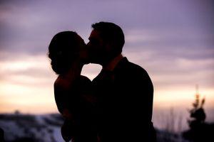 Ilana_Dave_Stein_Eriksen_Lodge_Deer_Valley_Park_City_Utah_Bride_Groom_Kissing_At_Sunset.jpg