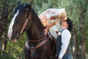 Kristin_Haven_Blacksmith_Fork_Canyon_Bride_On_Horse_Kissing_Groom.jpg