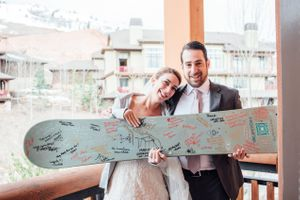 Ilana_Dave_Canyons_Resort_Park_City_Utah_Bride_Groom_Show_Off_Signed_Skiboard_Before_Skiing_and_Boarding.jpg