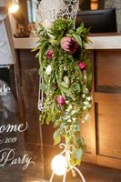 Utah_Bride_and_Groom_White_Party_2019_Snowpine_Lodge_Alta_Utah_Hanging_Accent_Lighted_Floral_Piece.jpg