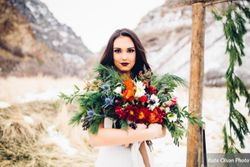 Romantic_Winter_Shoot_Bride_Evergreen-Draped_Backdrop.jpg