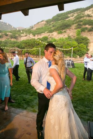 Tori_Sterling_Quiet_Meadow_Farms_Mapleton_Utah_Bride_Groom_Kissing_After_Garter_Toss.jpg