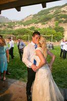 Tori_Sterling_Quiet_Meadow_Farms_Mapleton_Utah_Bride_Groom_Kissing_After_Garter_Toss.jpg