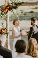 Linnea_Chaz_Red_Pine_Lodge_The_Canyons_Park_City_Bride's_Vows_Autumn_Floral_Backdrop.jpg